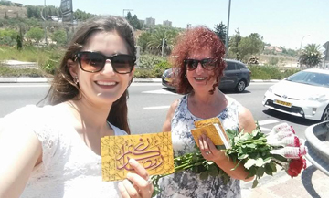 passing-out-flowers-Karmiel_featured